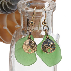 Lightweight green sea glass pieces are set with 14K Goldfilled Sandollar charms on professional grade earring wires.