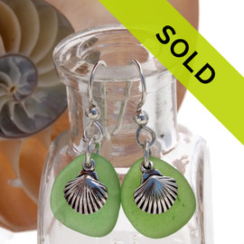 A simple pair of genuine green sea glass earrings with sterling shell charms in a lightweight simple setting. Sorry this sea glass jewelry item has been sold!