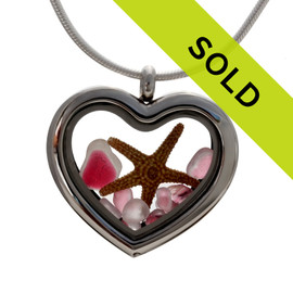 Our new heart lockets make this pink flashed sea glass really shine! A tiny starfish completes the beachy look! Genuine beach found glass. Sorry this sea glass jewelry piece has been sold!