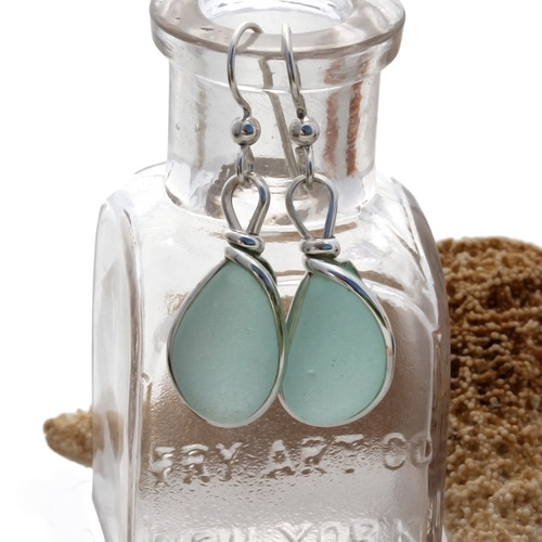 Vivid pieces of natural bright light aqua blue sea glass set in our Original Wire Bezel© earring setting. Unaltered genuine sea glass from Seaham England and the site of former glass factories that discarded glass into local waters.