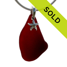 RARE Ruby Red natural beach found Sea Glass is combined on a Solid Sterling cast bail with a detailed Starfish and presented on an 18 Inch solid sterling snake chain. Sorry this sea glass jewelry piece has been sold!