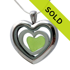 A Seafoam Rare Lime Green sea glass heart in a heart locket in this sea glass locket necklace. Sorry this sea glass jewelry selection has been sold!