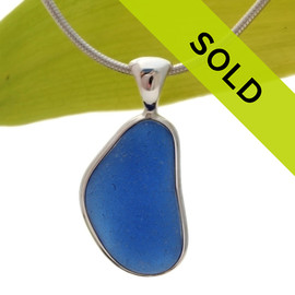 A bright vivid medium blue in this very old English Sea Glass piece and set in our Original Wire Bezel© necklace pendant setting. Sorry this sea glass jewelry piece has been sold!