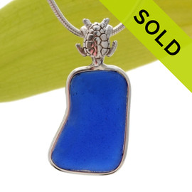 This is a squarish Cobalt Blue piece of naturally found sea glass in my Deluxe Wire Bezel© setting with a solid sterling silver sea turtle detail. This sea glass jewelry piece is left just the way it was found on the beach. SOLD - Sorry this Sea Glass Pendant is NO LONGER AVAILABLE!