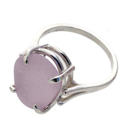 An unaltered lavender or purple sea glass piece set in a simple sterling basket ring.