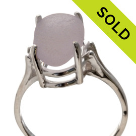 An unaltered lavender or purple sea glass piece set in a simple sterling silver basket ring. SOLD - Sorry this Sea Glass Ring is NO LONGER AVAILABLE!