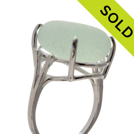 An UNALTERED piece of seafoam green sea glass set in a genuine sea glass ring.