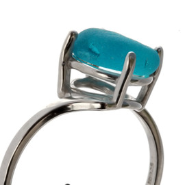An UNALTERED piece of Electric Aqua blue sea glass set in a ring.