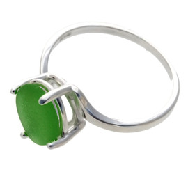 An UNALTERED piece of beach found green sea glass set in a sold sterling ring.