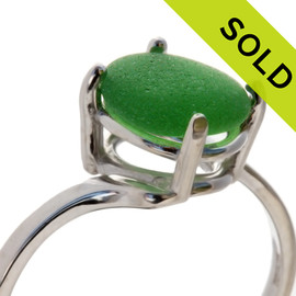 A perfect piece of natural VIVID green beach found Sea Glass piece securely set in a solid sterling silver 4 prong ring. Sorry this sea glass ring has been SOLD!