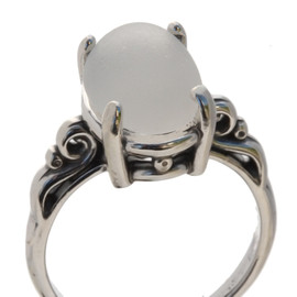 A natural UNALTERED pure white sea glass piece set in a sterling silver scroll ring. The sea glass is loosely set but will be fully set upon arrival. This is the EXACT ring you will receive!