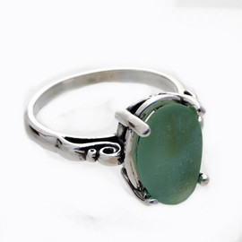 A natural UNALTERED pure mixed green sea glass piece set in a sterling silver scroll ring. The sea glass is loosely set but will be fully set upon arrival. This is the EXACT ring you will receive!