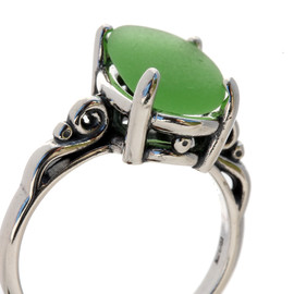 A natural UNALTERED pure bright green sea glass piece set in a sterling silver scroll ring. The sea glass is loosely set but will be fully set upon arrival. This is the EXACT sea glass ring you will receive!