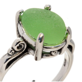 A natural UNALTERED pure bright yellowy seafoam green sea glass piece set in a sterling silver scroll ring. The sea glass is loosely set but will be fully set upon arrival. This is the EXACT sea glass ring you will receive