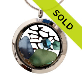 Blue and olive sea glass combined with a real piece of seafan and brightened up a aquamarine gem. Sorry this sea glass jewelry selection is no longer available.