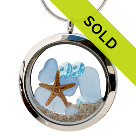 Light Blue beach found sea glass combined with a real starfishand  and brightened up 3 large aquamarine gems . A great sea glass locket necklace for anyone, specially a March Beach Baby! Sorry this sea glass jewelry piece has been sold!