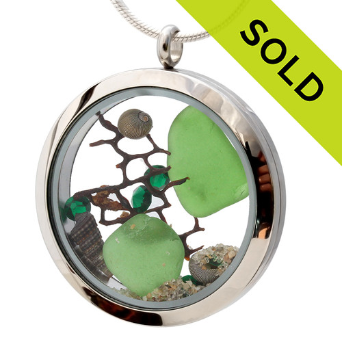 Emerald Green beach found sea glass combined with a real seafan and brightened up emerald green gems. Sorry this Sea Glass Jewelry selection has been SOLD!
