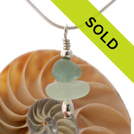 An light and airy  mix of sea green and off white in this English sea glass stacked necklace.