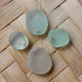 4 pieces of pre-drilled sea glass pieces for your sea glass jewelry making projects.