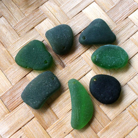 7 pieces of pre-drilled green sea glass pieces for your sea glass jewelry making projects.