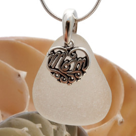 A piece of pure white genuine sea glass with a solid sterling bail and MOM charm. This piece comes complete with our sterling 1MM snake chain.