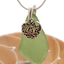 A very nice piece of peridot green sea glass necklace with a solid sterling silver mom charm.