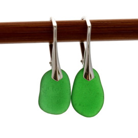 Shaped only by the sea, these unusual vivid green natural sea glass pieces really glow hanging from these solid sterling silver leverback earrings.