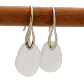 A pair of natural beach found sea glass earrings in a winter white on sterling silver deco hooks. Simple and elegant, these sea glass earrings are bound to be a hit!