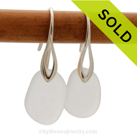 A pair of natural beach found sea glass earrings in a winter white on sterling silver deco hooks. Sorry this sea glass jewelry selection has been sold!