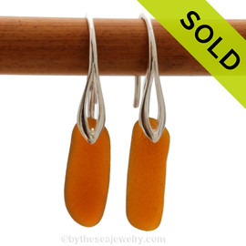 A pair of natural beach found Sea Glass Earrings in a glowing amber on sterling silver deco hooks. Simple and elegant, these sea glass earrings are bound to be a hit! Sorry this Sea Glass Jewelry selection has been sold!