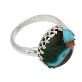 A sea glass marble fragment set in a gallery wire bezel ring.  This is a genuine beach found sea glass marble