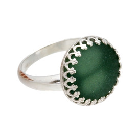 A seaweed green sea glass piece set in a gallery wire bezel ring.  This is a genuine beach found sea glass that has not been altered in any way!