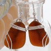Larger chocolate brown sea glass earrings in triple solid sterling silver setting.