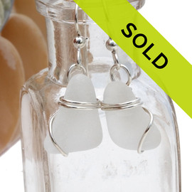 TOP QUALITY Certified Genuine Sea Glass Earrings in a simple solid sterling silver setting that maximizes the bling of metal yet leaves most of the sea glass open to glow. Sorry this sea glass jewelry item has been sold!