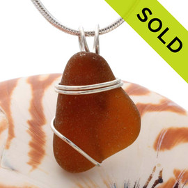 A smaller piece of bright amber brown sea glass pendant set in a simple secure sterling silver setting. SOLD - sorry this sea glass jewelry piece has been sold!