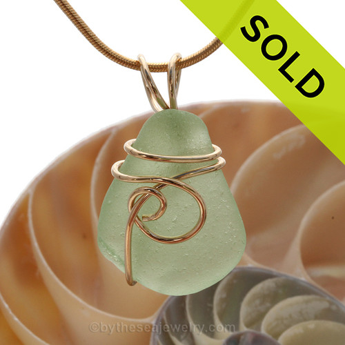 A smaller piece of yellowy seafoam green sea glass in one of our signature settings. A great smaller pendant for any necklace. Sorry this Sea Glass Jewelry piece has been SOLD!