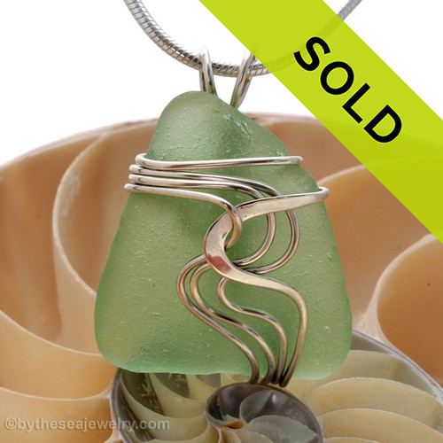 Top quality seafoam green sea glass set in our signature WAVES pendant setting. This setting leaves the sea glass totally UNALTERED from the way it was found on the beach! Sorry this sea glass jewelry piece has been sold!