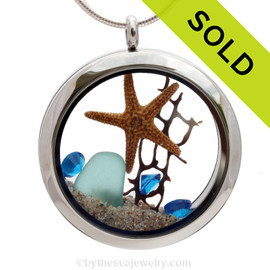 Aqua sea glass combined with a real starfish and seafan piece and beach sand an finished with tropical aqua blue gems. Sorry this sea glass jewelry selection has been sold!