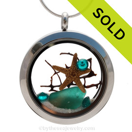 Vivid electric teal genuine beach found sea glass combined with a real starfish, a bit of seafan and crystal gems, a real underwater scene. Sorry this sea glass jewelry piece has been sold!