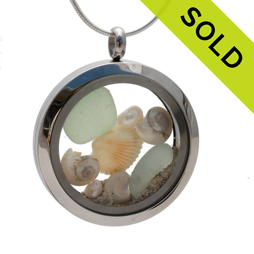 Soft green (seafoam) sea glass combined with pearlized mini nautilus shells and fresh water pearls. Beach sand makes this your own personal beach on the go! Sorry this Sea Glass Jewelry selection has already been SOLD!