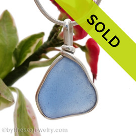 A nice piece of well aged Carolina Blue sea glass  with in our signature Original Wire Bezel© pendant. Sorry this sea glass jewelry piece has been sold!