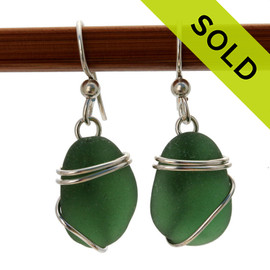 Genuine seaweed green sea glass pieces set in a simple sterling silver for a lovely pair of sea glass earrings. SOLD - Sorry this Sea Glass Jewelry selection is NO LONGER AVAILABLE!
