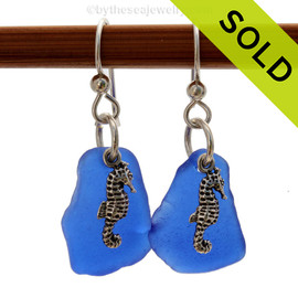 Genuine beach found blue sea glass earrings detailed with solid sterling seahorse charms. Sorry this sea glass jewelry selection is no longer available.