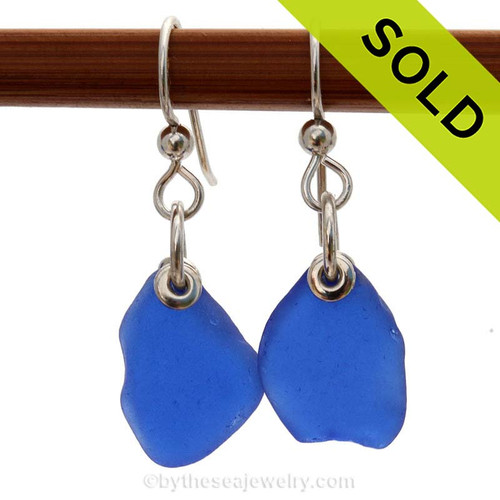 Simple irregular pieces of beach found blue sea glass set in a simple earring. Sorry this Sea Glass Jewelry selection has been SOLD!