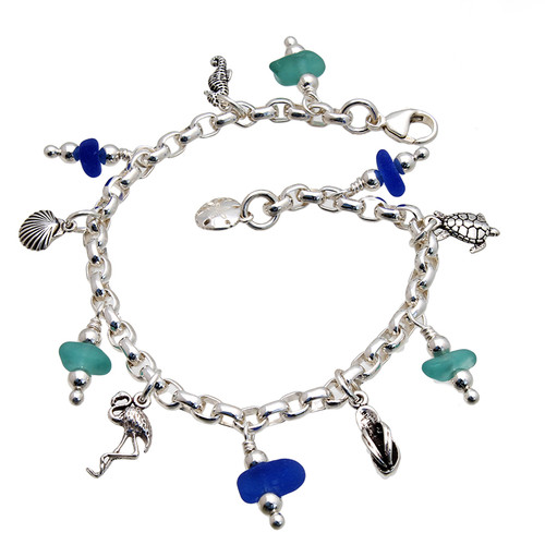 3 pieces of aqua and 3 Blue genuine beach found sea glass combined with solid sterling beach inspired charm in a totally solid sterling silver bracelet. All solid sterling charms that will remind you of your time at the beach!