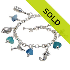 Sorry this sea glass bracelet has been sold! 5 pieces of mixed Victorian English Sea Glass combined with solid sterling beach inspired charms in a totally solid sterling silver bracelet.  All solid sterling charms that will remind you of your time at the beach!
