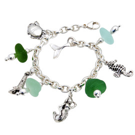 4 pieces of top quality Victorian English Sea Glass combined with solid sterling beach inspired charms in a totally solid sterling silver bracelet.  All solid sterling charms that will remind you of your time at the beach!