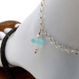 A simple white and aqua sea glass anklet with AAA Grade pearls for your beach trips this summer. Solid Sterling soldered chain with soldered utility links ensure this piece will remain with you always!