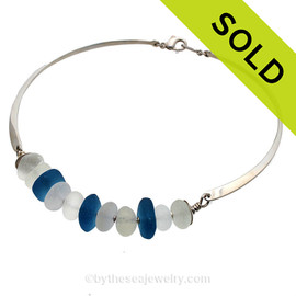 A stunning statement making sea glass necklace with perfect white English sea glass and vivid blue recycled glass beads on sterling. Sorry this one of a kind Sea Glass Jewelry piece has been SOLD!