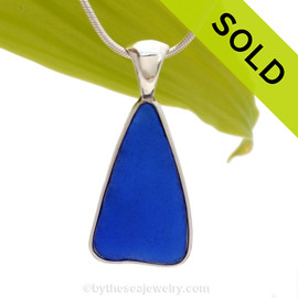 A nice piece of triangular Vivid Blue Genuine Sea Glass with in our signature Deluxe Wire Bezel© pendant setting that leaves both front and back open and the glass unaltered from the way it was found on the beach. Sorry this one of a kind sea glass jewelry piece has been SOLD!